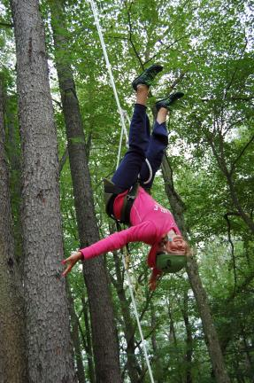 Gail Maholick/TIMES NEWS Jocelyn Mansberry learns how freeing tree climbing can be during Conservation Camp sponsored by Carbon County Environmental Education Center. The camp was held this week at Camp Shehaqua at Hickory Run State Park.