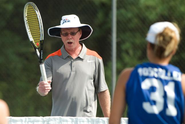 bob ford/times news Jim Thorpe tennis coach Norb Lienhard instructs players during a recent practice. Lienhard is beginning his 15th season as the girls tennis coach and has coached the boys team 17 seasons.