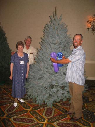STACEY SOLT/SPECIAL TO THE TIMES NEWS Celebrating their Grand Champion win are owners Margaret, Francis, and Chris Botek. The family traveled to North Carolina to compete in the annual National Christmas Tree Association's annual competition and…