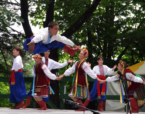 AL ZAGOFSKY/SPECIAL TO THE TIMES NEWS Defying gravity, dancers from the Kashtan Ukrainian Dance Ensemble from Cleveland, Ohio performed at the Ukrainian Homestead's Ukrainian Song & Dance Festival.
