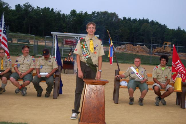 TERRY AHNER/TIMES NEWS  Robert Keyser (standing) speaks at his Eagle Court of Honor held recently at the Stoney Ridge P.A.R.C. in Lower Towamensing Township. Pictured behind Keyser are (l-r) Charles Sterling, senior patrol leader of Troop 20 and…
