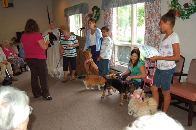 LINDA KOEHLER/TIMES NEWS It was the 4th Annual Pet Show at Mrs. Bush's Personal Care Home and several dogs and their owners paid a delightful visit with the residents.