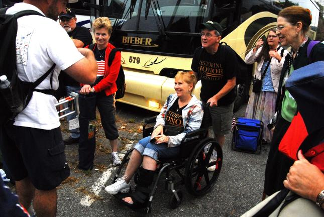 "Ron Gower/TIMES NEWS Sandy Dellicker of Summit Hill doesn't let an ankle injury stop her from attending the ""Restoring Honor"" rally in Washington D.C. on Saturday. She is pushed in a wheelchair to the event after leaving bus in the parking lot of…"