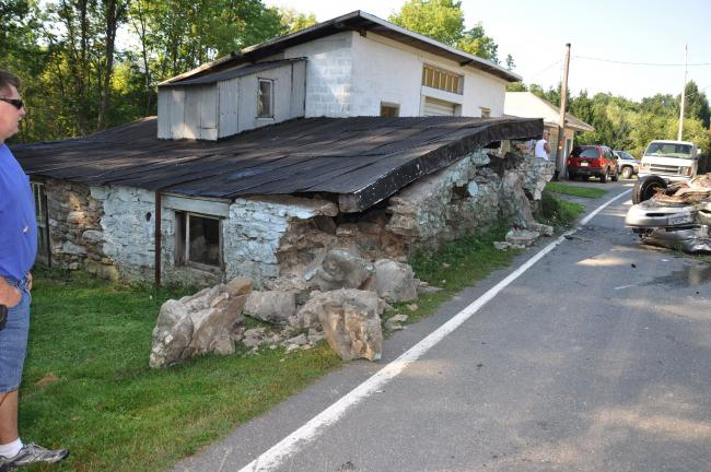 RON GOWER/TIMES NEWS A 160-year-old stone garage was struck by a car in the West White Bear Drive section of Summit Hill this morning.