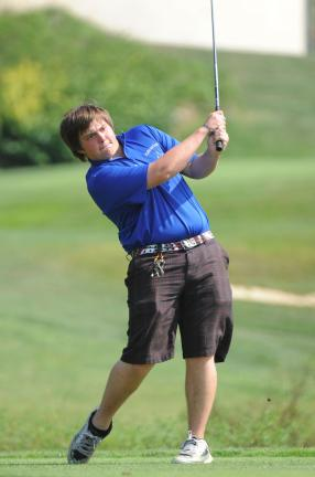nancy scholz/times news Palmerton's Billy Heinick watches his shot during Wednesday's match against Northwestern.