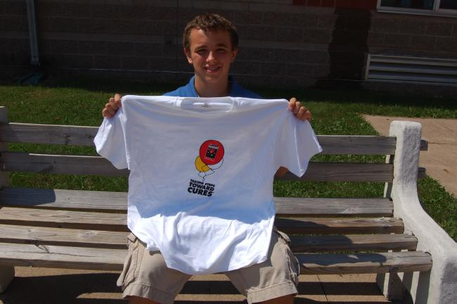 TERRY AHNER/TIMES NEWS Tyler Sawyer, a junior at Lehighton Area High School, holds a T-shirt he plans to sell to students in memory of his cousin, who passed away last year to leukemia. The fundraiser represents a portion of Sawyer's senior project.
