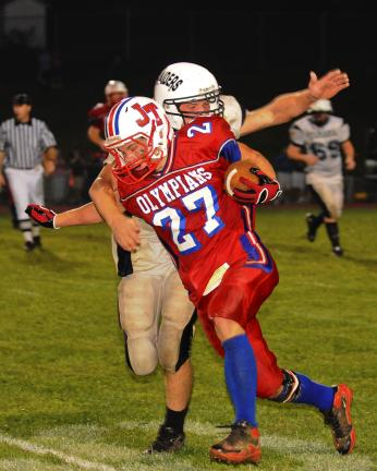 steve shinko/times news Jim Thorpe's Jon Fritz (27) carries the ball as Tamaqua's Matt Edmonds tries to make the tackle.