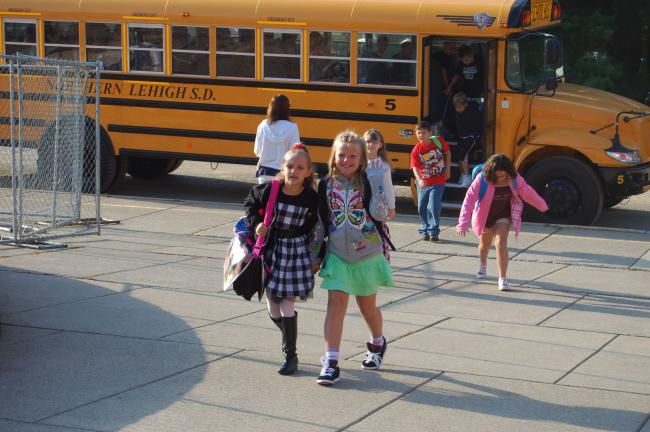 TERRY AHNER/TIMES NEWS This smiling collection of Slatington Elementary pupils exit their buses Tuesday morning on the first day of classes in the Northern Lehigh School District.