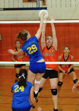Steve Shinko/Special to THE TIMES NEWS Weatherly's Alyssa Kephart (13) tries to block a spike by Marian's Tori Vadyak (29) during Tuesday night's game at Weatherly.