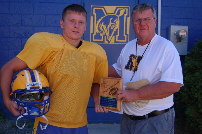 Marian running back Paul Martin (left) receives THE TIMES NEWS Player of the Week award from Colts Coach Stan Dakosty. Martin carried 19 times for 205 yards and 2 TDs in Marian's 28-17 win over Lehighton. JOE PLASKO/TIMES NEWS