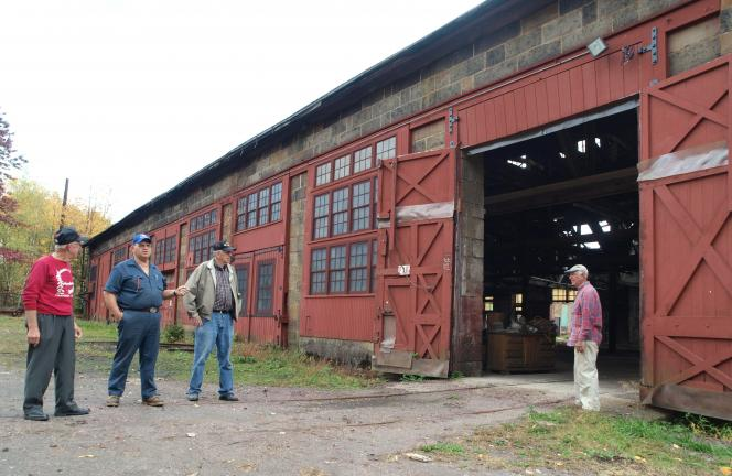 AL ZAGOFSKY/SPECIAL TO THE TIMES NEWS The Rotary Foundation managed the Weatherly Train Works project until it was purchased by the Borough of Weatherly and turned over to the Committee to Restore and Preserve the former L.V.R.R. Engine Shop…