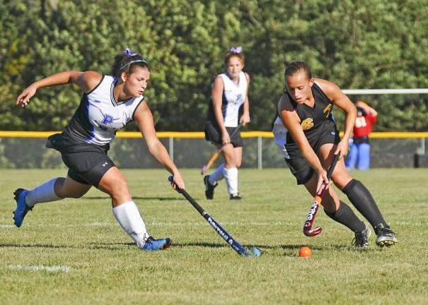 Steve Shinko/Special to THE TIMES NEWS Palmerton's Kylee Turko (9) tries to steal the ball from Northwestern Lehigh's Lauren Horner (6) during Tuesday's girls field hockey game at Palmerton. ?
