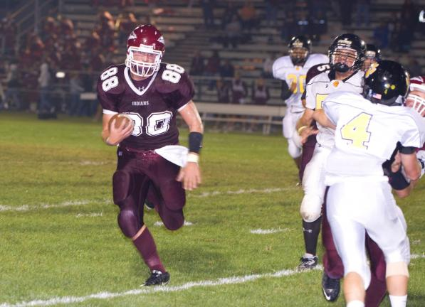 bob ford/times news Lehighton's Jacen Nalesnik (88) followers his blockers after taking a handoff. Kevin Dunn (4) is the Panthers' defender.