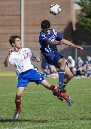 BOB FORD/TIMES NEWS Tamaqua's Gonzalo Hernandez Cascante heads the ball away from Jim Thorpe's Caleb Heller during Saturday's 5-1 Blue Raiders win.