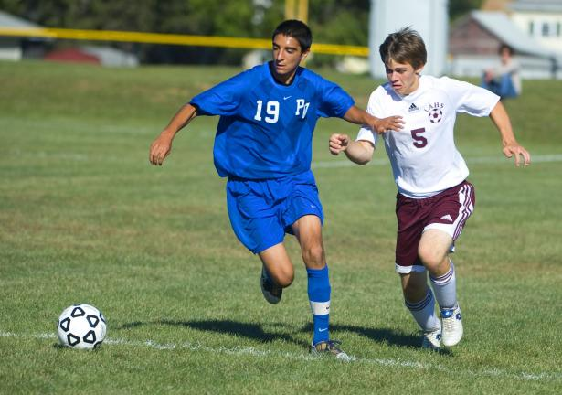 Alex Mansour of Pleasant Valley moves in front of Lehighton's Nick Kern as the two try to take possession of the ball during Monday's Mountain Valley Conference soccer match. The Bears won, 8-1. BOB FORD/TIMES NEWS
