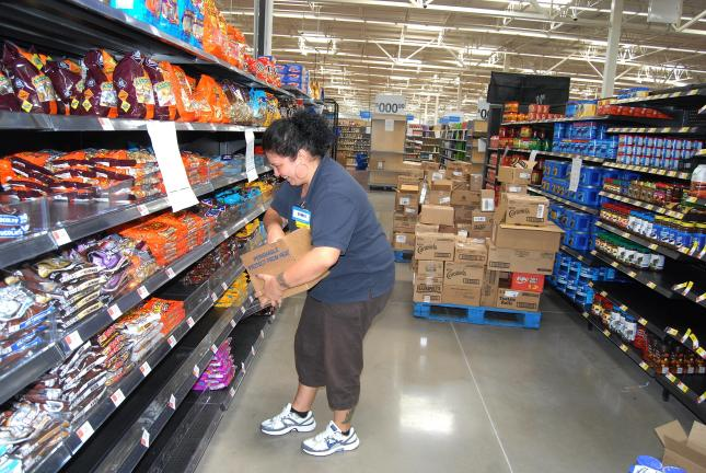 Ron Gower/TIMES NEWS Bambi Taschler stocks shelves at the new Wal-Mart super center in Mahoning Township. The store, located about a half-mile west of the existing Wal-Mart along Route 443, will open at 8 a.m. on Wednesday, October 13.