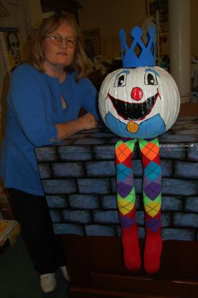 LINDA KOEHLER/TIMES NEWS Geraldine Shaffer and the Slatington Library invites everyone to enter the Great Colorful Pumpkin Contest. She says to let your imaginations run wild to come up with ideas like the Humpty Dumpty pumpkin she painted.