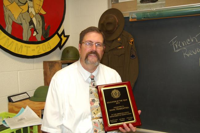 LINDA KOEHLER/TIMES NEWS Mark Tramontina, a Pleasant Valley High School social studies teacher, is honored to be named the 2010 Pennsylvania state American Legion Educator of the Year. He was nominated by American Legion Post 927 for his dedication…