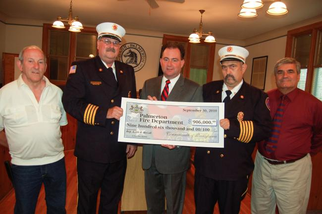 TERRY AHNER/TIMES NEWS Among those on hand Thursday to accept the $906,000 grant secured by state Rep. Keith McCall for the eventual construction of a new fire station in Palmerton, are from left, council President Terry Costenbader; West End Fire…