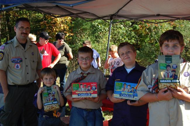 With Cubmaster Mike Hoffman are scouts Steven Hoffman, Jason Check, Sean Kreglow and Justin Bennett of Pack 66. They were selling caramel corn.