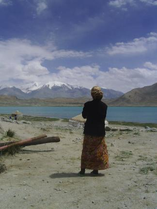 Like a page out of National Geographic, a Uyghur woman, Karakul Lake and the snow-capped mountains. For additional photos, visit http://www.btay200.blogspot.com/