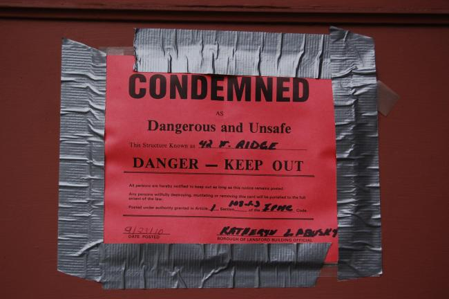 CHRIS PARKER/TIMES NEWS A notice of condemnation is taped to the front door of the former English Congregational Church.