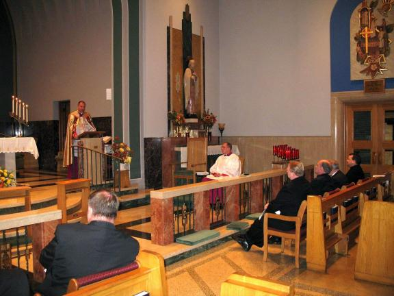 Special to the TIMES NEWS Bishop John O. Barres (standing), Bishop of the Diocese of Allentown, addresses with the priests of the Carbon County Deanery during the first diocesan Holy Hour for the priests of the Allentown Diocese.