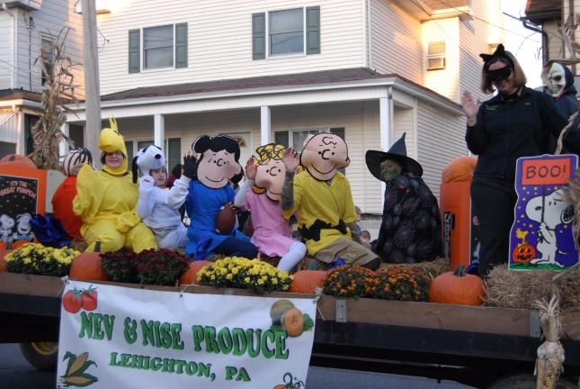 "Ron Gower/TIMES NEWS Cartoon characters with the theme ""It's a Great Pumpkin Patch Charlie Brown,"" ride the float of Nev & Nise Produce of Mahoning Township in the 40th annual Lehighton Area Halloween Parade on Saturday. The float took a first-place…"