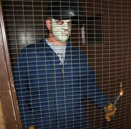 "ANDREW LEIBENGUTH/SPECIAL TO THE TIMES NEWS ""Jason"" terrifies visitors with banging and sparks as they pass through an unlit haunted house during the Tamaqua YMCA's first annual community Halloween Party held recently."