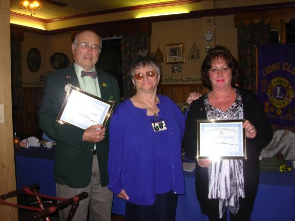 ADELE R. ARGOT/SPECIAL TO THE TIMES NEWS Recognized as Lions of the Month of the Western Pocono Lions Club, by club President Helen Koshensky were, left, PCC Lion Christopher Sweeney and, right, Lion Kathy Pagano. Sweeney was recognized for again…