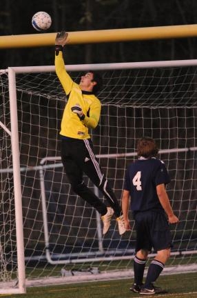 Nancy Scholz/Special to the TIMES NEWS Tamaqua goal keeper Zack Lakitsky knocks the ball away from the cage during Thursday's district playoff game against Salisbury.