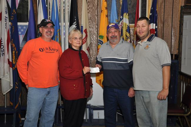 Officers of the Sons of American Legion Post 316, Summit Hill, present Rose Marie Armon, director of the Summit Hill Food Pantry, second from left, with a check for $2,000 to purchase 135 frozen turkeys for families in need in Summit Hill. Members…