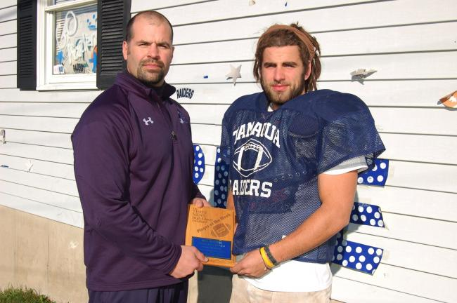 Tamaqua coach Sam Bonner (left) congratulates Blue Raiders senior running back Grif Griffiths for receiving THE TIMES NEWS Player of the Week award. Griffiths rushed 19 times for 161 yards and 3 TDs in the Raiders' 29-7 win over Minersville. JOE…