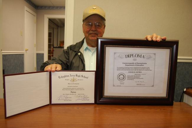TERRY AHNER/TIMES NEWS  Edward Hartman of Lehighton proudly displays the high school diploma (left) he received last month over a half-century after he received his GED from Lehighton Area High School, as well as a copy of the diploma (right)…