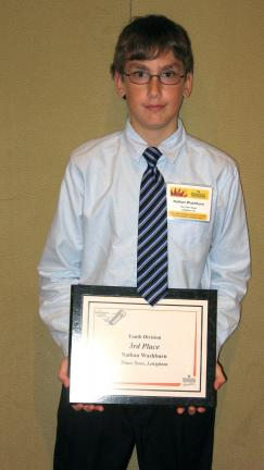 LINDA KOEHLER/TIMES NEWS Nathan Washburn of Palmerton won third place in the Youth Division of the 2010 Pennsylvania Newspaper Association's Carrier of the Year awards.