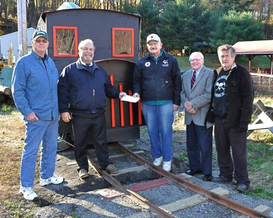 VICTOR IZZO/SPECIAL TO THE TIMES NEWS Representatives of the CSIDC visited the No. 9 Mine & Museum in Lansford to present a donation to help complete the setup and installation of a small steam engine, its cars, and tracks which have been donated to…
