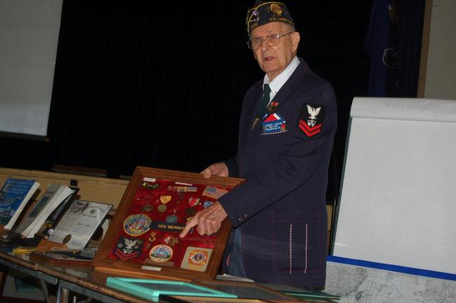 TERRY AHNER/TIMES NEWS Veteran Al Kohler proudly displays his impressive list of medals and other awards he's accumulated throughout his lifetime during a Veterans Day assembly Thursday at Palmerton Area High School.