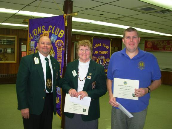 "Immediate Past District Governor, Lion Bob Neumoyer, left, presented certificates of recognition to Lion Adele Argot, center, and Lion Larry Williams for serving as co-chairs for their respective region for the ""Lions, Feeding the Hungry"" project. A…"