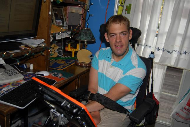"Ron Gower/TIMES NEWS Robert ""Bobby"" O'Gurek, 30, of Summit Hill, sits in his wheelchair at the computers in his home. O'Gurek is afflicted with cerebral palsy. Despite the medical condition, he graduated not only from high school, but from college,…"
