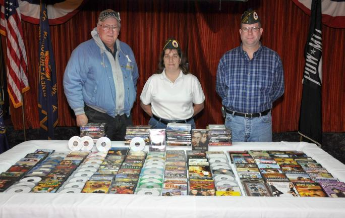 AMY MILLER/TIMES NEWS Officers at the AMVETS Post 83 showcase the DVDs that have been collected to date for Task Force DVD. The DVDs will now be shipped to soldiers serving overseas. Officers are, from left, Perry Shelton, judge advocate; Laurel…