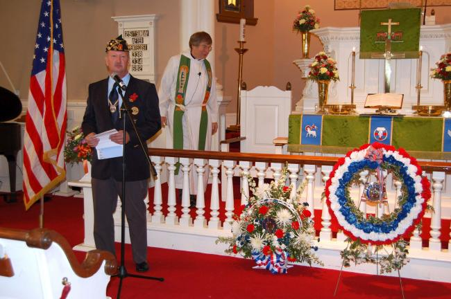 Dennis Ziegler, chairman of the Veterans Day committee, led a service to honor veterans both living and dead, at Union United Church of Christ, Neffs. Behind him is the Rev. Tom Thomas of Union UCC.