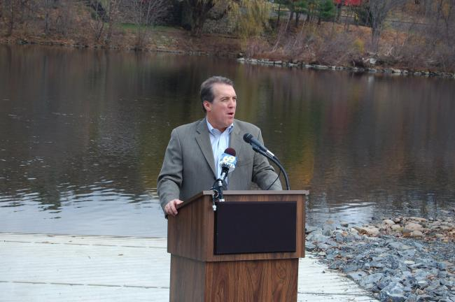 Lehigh County Executive Don Cunningham, left, speaks at a news conference Monday about the 12 acres of land Pfizer Inc. donated to the county for use as a public recreation area. The new Lehigh River boat ramp was also opened as well. At right, Dan…