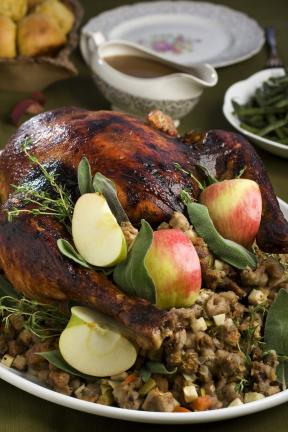 AP PHOTOs/LARRY CROWE The flavors of the season are front and center in this recipe for Maple-cider glazed turkey with gravy and apple-onion stuffing.