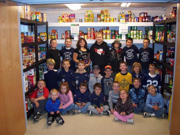 Members of Cub Pack 138 with food items destined for local food pantries.