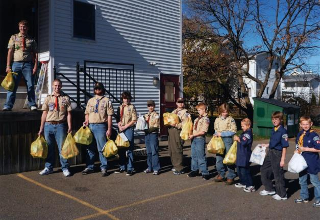SPECIAL TO THE TIMES NEWS Boy Scout Troops show how a joint effort can move food effortlessly. From left are, Adam Reichard, Sean Maloney, Justin Wingert, Logan Berger, Jacob Hoffner, Michael Turner, Alex Lambert, Ethan Dubble, Kenny Schleicher,…