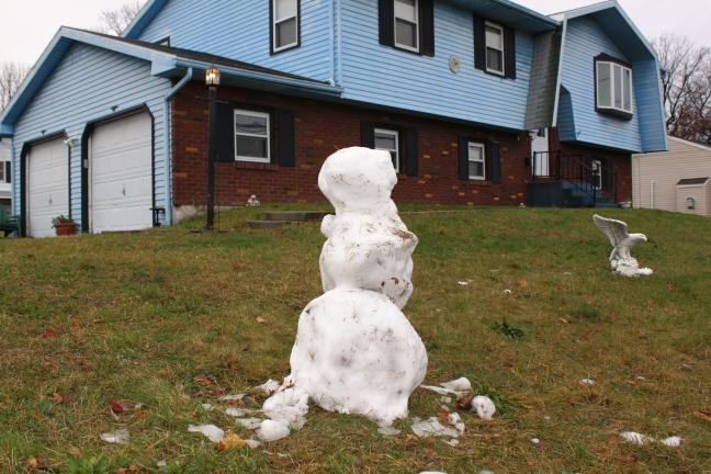 Andrew Leibenguth/SPECIAL TO THE Times news YESTERDAY THANKSGIVING DAY SNOW WAS ENOUGH TO MAKE A MINI-SNOWMAN OUTSIDE THIS HOME ON WEST PHILLIPS STREET IN COALDALE.