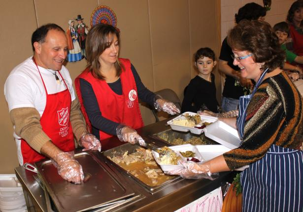 Andrew Leibenguth/SPECIAL TO THE Times News Volunteers helped the Tamaqua Salvation Army provide free Thanksgiving Day dinners to the community. Pictured filling take-out orders, from left are, Carlos Ortiz, Sharon House, Kayla Nothstein, and Lisa Krouse.