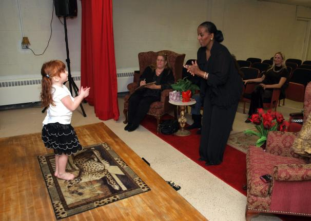 AL ZAGOFSKY/SPECIAL TO THE TIMES NEWS At audition, Madeline Millard performs for choreographer Theressa DuBois of Lehighton's Deaf Welcome Center, as Lisa Giordano, wife of lead singer CMG and mom, Stephanie Millard, enjoy.