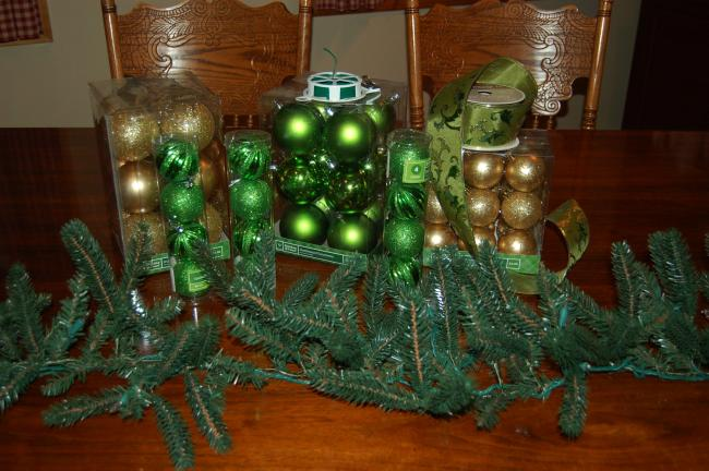 KAREN CIMMS/TIMES NEWS A pre-lit pine garland, some unbreakable ornaments, and a little wire are about all you really need to create a fabulous Christmas decoration.