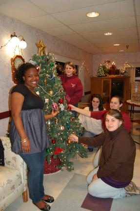Gail Maholick/TIMES NEWS Lehighton Girl Scout Ambassator Troop 3583 decorated a Christmas tree at The Summit at Blue Mountain Health Systems. Participating in the project were, from left, Shaniqua Francis, Samantha Bowman, Clair-Ann Ahner, Chelsea…